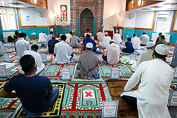 © Licensed to London News Pictures. 31/07/2020. London, UK. Worshippers pray at Wightman Road Mosque, also known as London Islamic Cultural Society and Mosque, in north London as Muslims celebrate the festival of Eid. Last month the government announced that gatherings of more than 30 worshippers are allowed for acts of communal worship in churches, synagogues, mosques, temples and other places of worship. All worshippers attending Mosques for Eid celebrations have to wear face coverings and bring their own prayer mat, Quran, and a reusable shoe bag. Eid al-Adha, also called Eid Qurban or Bakra-Eid, is the second of two Islamic holidays celebrated worldwide each year, and considered the holier of the two. Photo credit: Dinendra Haria/LNP