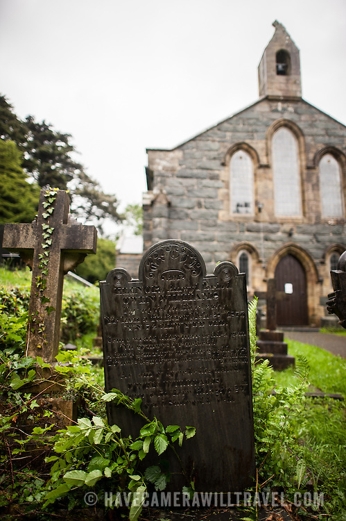 St. Tanwg's Church  and graves in Harlech on Wales's northwestern coast, in Snowdonia.