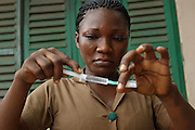 Ghana: 25 April 2012, A nurse prepares a dose of measles vaccine at the Dodowa new town health outreach point in Dodowa.The GAVI Alliance is a public-private partnership that brings together developing country and donor governments, WHO, UNICEF, the World Bank, the vaccine industry in both industrialised and developing countries, research and technical agencies, civil society, the Bill & Melinda Gates Foundation and other private philanthropists.  Set up in 2000 as the Global Alliance for Vaccines and Immunisation, GAVI's mission is to save children's lives and protect people's health by increasing access to immunisation in the world's poorest countries.