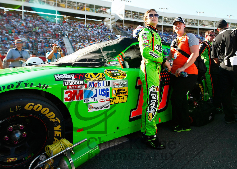 Driver Danica Patrick waits by her car before the start of the NASCAR Sprint Cup Series Coca-Cola 600 autorace in Concord, North Carolina May 27, 2012. REUTERS/Chris Keane (UNITED STATES)