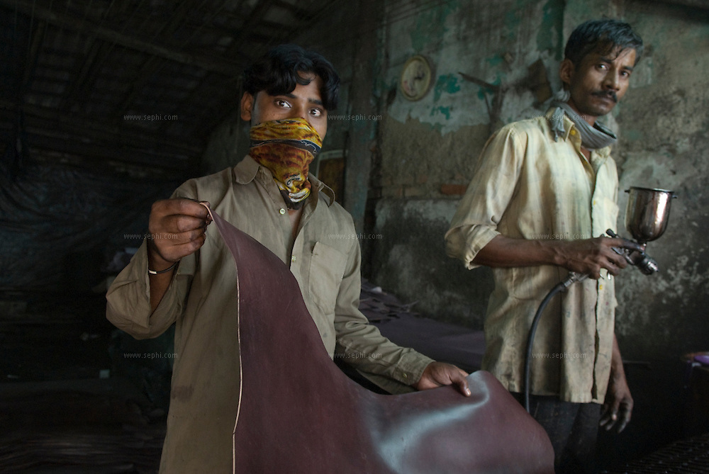 workers spray-paint cowhides in the Kalyanwadi tanning area. Dharavi, August 2007