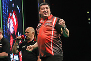 Mensur Suljović celebrates winning a point during the PDC Premier League Darts at Arena Birmingham, Birmingham, United Kingdom on 25 April 2019.