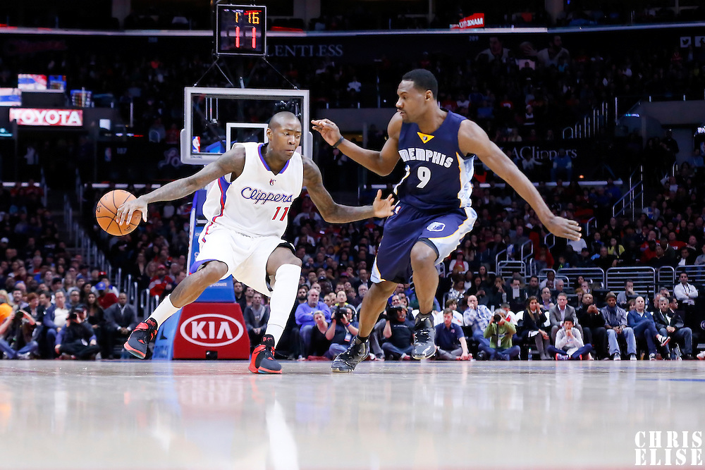 23 February 2015: Los Angeles Clippers guard Jamal Crawford (11) drives past Memphis Grizzlies forward Tony Allen (9) during the Memphis Grizzlies 90-87 victory over the Los Angeles Clippers, at the Staples Center, Los Angeles, California, USA.