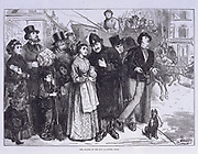 Members of the public watching the solar eclips in London .  Street scene with a crowd of people all gazing up at the sky.  From 'The Illustrated London News', Vol 57 (London, c1870).