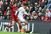 Liverpool defender Trent Alexander-Arnold (66) gets the tackle on Burnley midfielder Dwight McNeil (31) during the Premier League match between Liverpool and Burnley at Anfield, Liverpool, England on 10 March 2019.