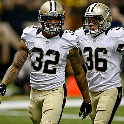 Aug 9, 2013; New Orleans, LA, USA; New Orleans Saints strong safety Kenny Vaccaro (32) celebrates with outside free safety Jim Leonhard (36) after a tackle against the Kansas City Chiefs during a preseason game at the Mercedes-Benz Superdome. The Saints defeated the Chiefs 17-13. Mandatory Credit: Derick E. Hingle-USA TODAY Sports