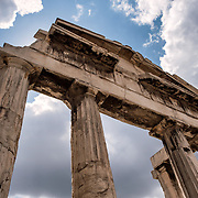 The Gate of Athena Archegetis was donated by Julius Caesar and Augustus and was dedicated in 11-10BC. It forms the west gate of the Ancient Agora. Built between 19 BC and 11 BC, the Roman Agora was the commercial center of ancient Athens. It featured a large rectangular building with an open courtyard surrounded by shops, storerooms, and offices.