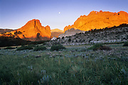 Full moon and morning alpenglow on Pike's Peak and Gateway Rocks, Garden of the Gods Park, Colorado Springs, Colorado