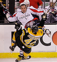 Washington Capitals forward Alex Ovechkin (8) and Boston Bruins defenseman Dennis Seidenberg (44) collide in the second period of game one of the NHL Eastern Conference Quarterfinal TD Garden in Boston, Massachusetts on April 12, 2012.    UPI/Matthew Healey