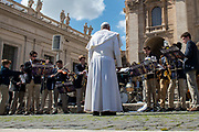 Youth play music to Pope Francis in Saint Peter's square at the end of a weekly general audience on March 14, 2018 at the Vatican.