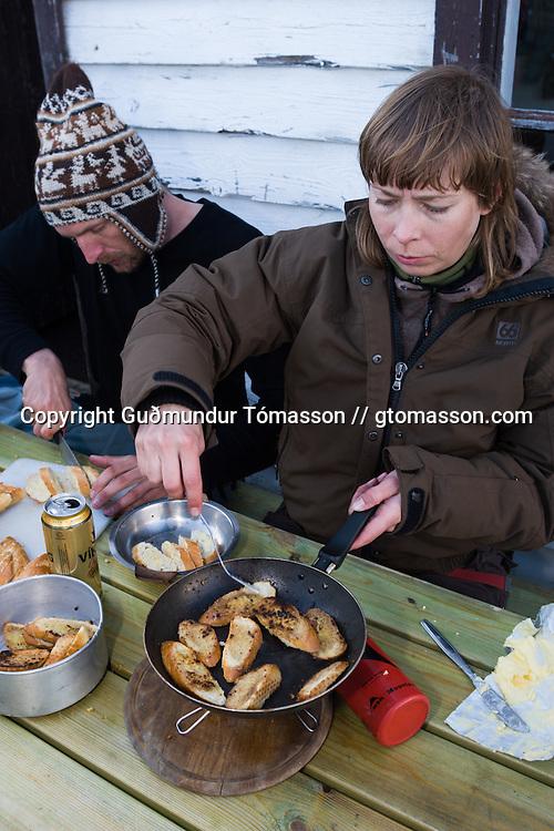 Helga Björt Möller and Óliver Hilmarsson cooking, Hvalvatnsfjörður, Iceland.