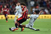 Marcus Rashford (19) of Manchester United tackles Nathan Ake (5) of AFC Bournemouth during the Premier League match between Bournemouth and Manchester United at the Vitality Stadium, Bournemouth, England on 18 April 2018. Picture by Graham Hunt.