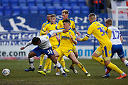 Neil Danns of Tranmere Rovers and Callum Reilly of Wimbledon  during the EFL Sky Bet League 1 match between Tranmere Rovers and AFC Wimbledon at Prenton Park, Birkenhead, England on 21 December 2019.