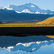 The Reflection of Mount Cho Oyu in Water at Dawn in the Himalaya Mountains of Tibet