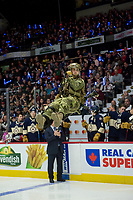 REGINA, SK - MAY 18: Brenna Baverstock repels to ice from the ceiling at the start of the game between the Regina Pats and the Hamilton Bulldogs at the Brandt Centre on May 18, 2018 in Regina, Canada. (Photo by Marissa Baecker/Shoot the Breeze)