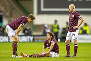 Christophe Berra (#6) of Heart of Midlothian checks on the injured Peter Haring (#5) of Heart of Midlothian during the Ladbrokes Scottish Premiership match between Hibernian FC and Heart of Midlothian FC at Easter Road Stadium, Edinburgh, Scotland on 29 December 2018.