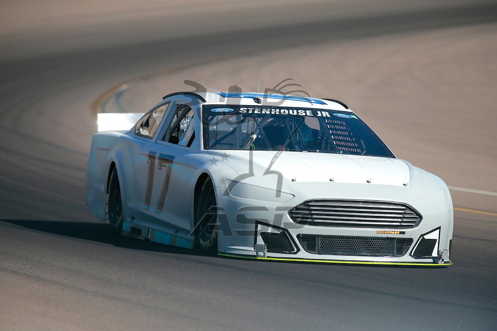 Avondale, AZ - Oct 14, 2015:  Ricky Stenhouse Jr. (17) brings his race car through the turns during the NASCAR Test at the Phoenix International Raceway in Avondale, AZ.