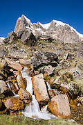 Nevado Cuyoc (Puscanturpa Sur, 5550 meters), above a stream in Cuyoc Valley. Day 5 of 9 days trekking around the Cordillera Huayhuash in the Andes Mountains, Peru, South America.