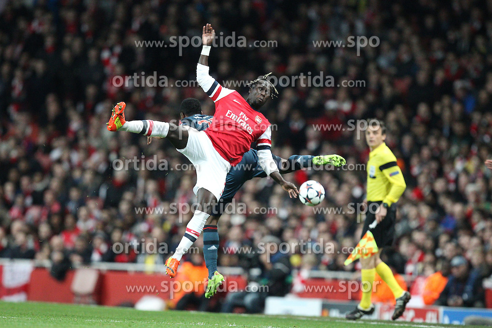 19.02.2014, Emirates Stadion, London, ENG, UEFA CL, FC Arsenal vs FC Bayern Muenchen, Achtelfinale, im Bild l-r: im Zweikampf, Aktion, Kopfballduell mit Bacary SAGNA #3 (FC Arsenal London), David ALABA #27 (FC Bayern Muenchen) // during the UEFA Champions League Round of 16 match between FC Arsenal and FC Bayern Munich at the Emirates Stadion in London, Great Britain on 2014/02/19. EXPA Pictures © 2014, PhotoCredit: EXPA/ Eibner-Pressefoto/ Kolbert<br /> <br /> *****ATTENTION - OUT of GER*****