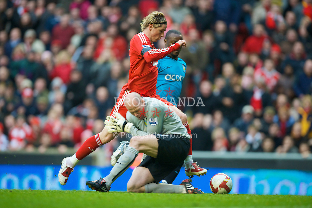 LIVERPOOL, ENGLAND - Sunday, March 22, 2009: Liverpool's Fernando Torres is brought down by Aston Villa's goalkeeper Brad Friedel, which resulted in the sending off of Friedel and a Liverpool penalty, during the Premiership match at Anfield. (Photo by David Rawcliffe/Propaganda)