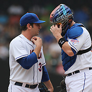 Matt Harvey, the New York Mets pitcher talking with catcher John Buck during the New York Mets V Cincinnati Reds Baseball game at Citi Field, Queens, New York. 22nd May 2012. Photo Tim Clayton