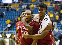 Jan 18, 2017; Morgantown, WV, USA; Oklahoma Sooners players celebrate after beating the West Virginia Mountaineers at WVU Coliseum. Mandatory Credit: Ben Queen-USA TODAY Sports