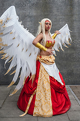 © Licensed to London News Pictures. 24/05/2015. London, UK. A girl dressed as Morgana from League of Legends poses, as fans of anime, comic books, video games and more gather in large numbers at the Excel Centre to attend the bi-annual MCM Comic Con. Photo credit : Stephen Chung/LNP