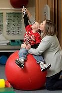 Certified occupational therapy assistant Erin Lynch works with Zachary Tuthill, 4, at Inspire in Goshen on Monday, May 10, 2010.
