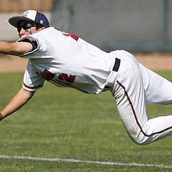 Maranatha High School leftfielder Tony Li (12) dives for a catch on a drive from Citrus Hill's Chris Verdin in the third inning of a baseball playoff game at Jackie Robinson Field Friday, May 22, 2009, in Pasadena,Calif. (Pasadena Star-News Keith Birmingham)