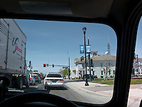 downtown Fallon, NV waiting for a redlight in a classic right hand drive Mini Cooper automobile
