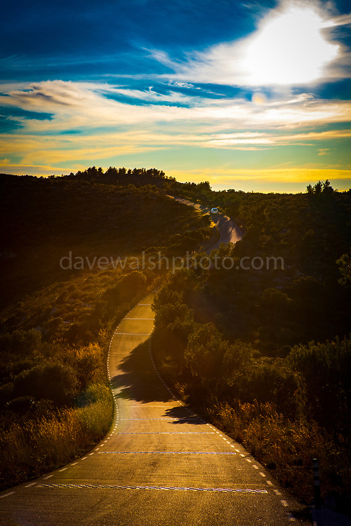A car on a winding road through the Parc Natural del Garraf