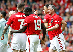 Manchester United Legends Ole Gunnar Solskjaer (right) celebrates scoring his side's first goal of the game during the legends match at Old Trafford, Manchester.