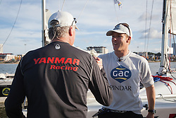 Ian Williams is congratulated by Peter Gilmour after winning the Alpari World Match Racing Tour at the 2012 Monsoon Cup. Kuala Terengganu, Malaysia. 6 December 2012. Photo: Subzero Images/Monsoon Cup