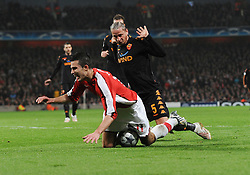 Robin Van Persie is fouled by AS Roma's Philippe Mexes resulting in an Arsenal penalty during the UEFA Champions League First knockout round, First Leg match between Arsenal and A.S. Roma at Emirates Stadium on February 24, 2009 in London, England