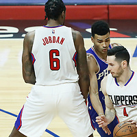11 March 2017: LA Clippers guard J.J. Redick (4) dries past Philadelphia 76ers guard Timothe Luwawu-Cabarrot (20) on a screen set by LA Clippers center DeAndre Jordan (6) during the LA Clippers 112-100 victory over the Philadelphia Sixers, at the Staples Center, Los Angeles, California, USA.