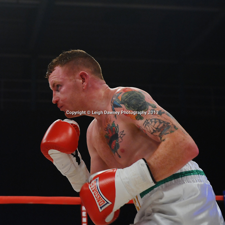 James Fryers defeats Michael Mooney (pictured)  in a Lightweight contest on 15th March 2014 at the Rivermead Leisure Centre, Reading, Berkshire. Promoted by Hennessy Sports. © Leigh Dawney Photography 2014.