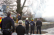 Fireman and others gather at the scene of a house explosion in the 2400 block of King Avenue in Dayton's Belmont neighborhood, Friday, March 2, 2012.