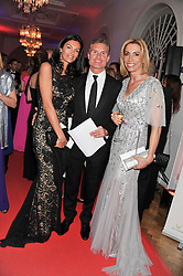 Left to right, KAREN MINIER, DAVID COULTHARD and ANITA GERHARDTER Chief Executive Officer of Wings For Life at the Cord Club's 'Wings For Life' Ball held at One Marylebone, London on 28th February 2013.