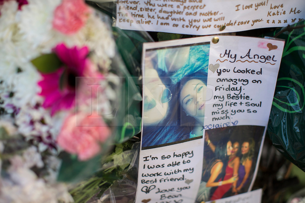 © licensed to London News Pictures. London, UK 26/08/2013. A message is seen on flowers at a floral memorial to nursery teacher Sabrina Moss who was shot dead in Kilburn while out celebrating her 24th birthday. Photo credit: Tolga Akmen/LNP