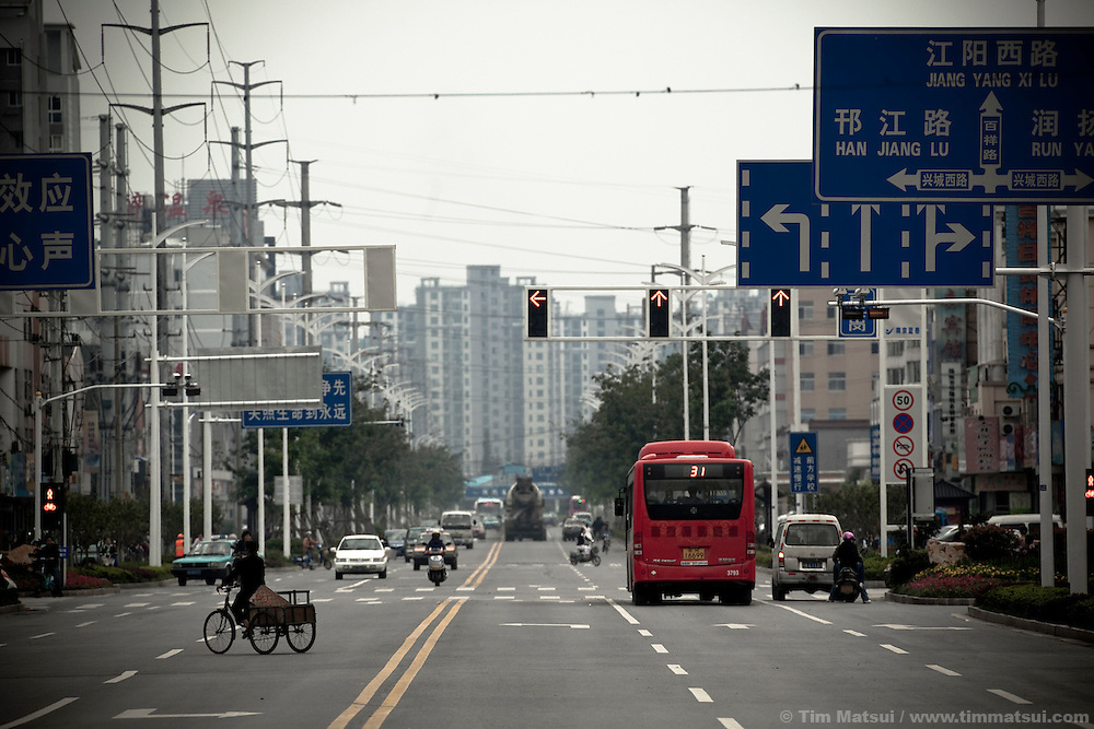 Broad boulevards for the traffic to come in the newly expanded parts of Yangzhou, China, a suburb city of Shanghai and major producer of photovoltaic cells for solar power.