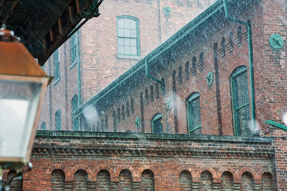 The rain came down in buckets during Daphina and Charles Engagement Lifestyle Photography Session. Toronto's Distillery District.