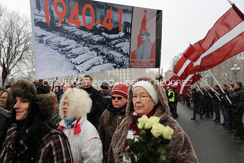A banner with crimes by Stalin army is showed during a parade of veterans who sided with the Nazis during World War Two, today in Riga, Latvia, Sunday 16, 2014. Veterans of the Latvian Legion, is a group formed in 1943 and commanded by the Nazi SS. Many Latvians consider the Waffen SS veterans as heroes who fought for independence against the Soviet Union, while Russians see the march as an attempt to glorify fascism and white wash a dark chapter in Latvia's history.
