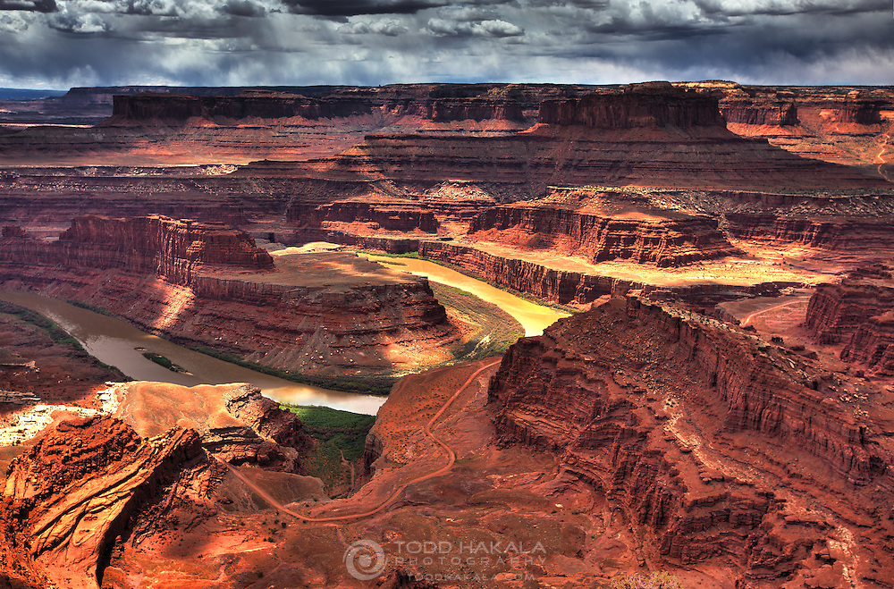 Clouds and sun illuminate the view from Dead Horse Point.
