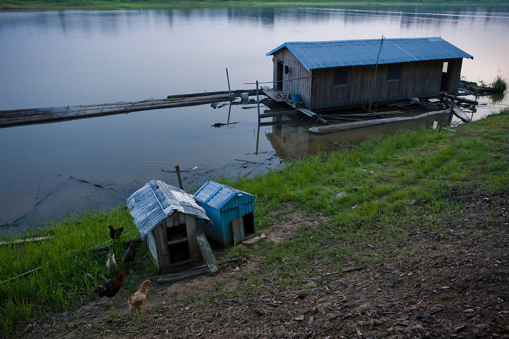 Brazilian fisherman João Agustinho Cardoso floating home on the Salimoes River in near the town of Manacapuru, Brazil.  (João Agustinho Cardoso is featured in the book What I Eat: Around the World in 80 Diets.)