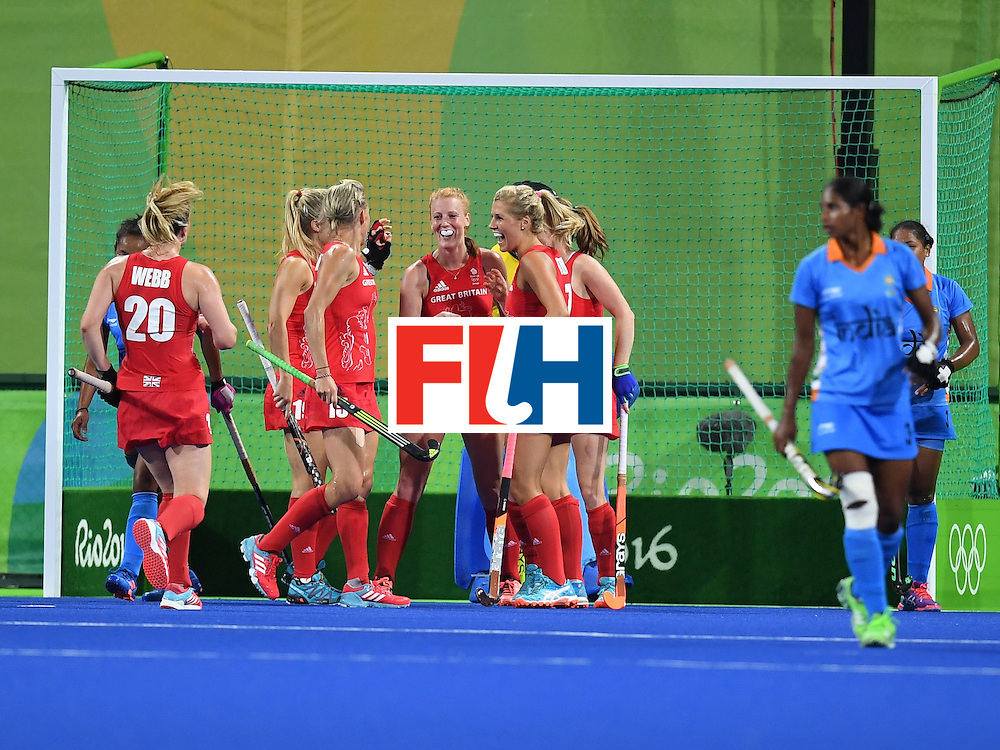 Britain players celebrate a goal during the women's field hockey India vs Britain match of the Rio 2016 Olympics Games at the Olympic Hockey Centre in Rio de Janeiro on August, 8 2016. / AFP / MANAN VATSYAYANA        (Photo credit should read MANAN VATSYAYANA/AFP/Getty Images)