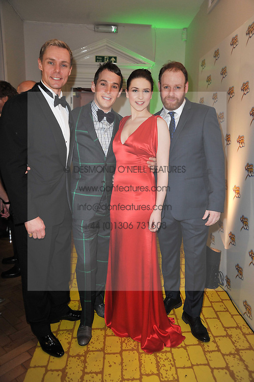 Left to right, EDWARD BAKER-DULY, DANIELLE HOPE, PAUL KEATING and DAVID GANLY at the press night of the new Andrew Lloyd Webber  musical 'The Wizard of Oz' at The London Palladium, Argylle Street, London on 1st March 2011 followed by an aftershow party at One Marylebone, London NW1