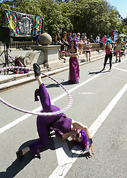 Unidentified women dance with hoops for passersby, during the 105th running of the Bay to Breakers 12k, Sunday, May 15, 2016 in San Francisco. The 7.42-mile race from San Francisco Bay to the Pacific Ocean, which attracts a field of tens of thousands of runners, from elite runners to weekend warriors, some clad in costume and some in nothing at all. (Photo by D. Ross Cameron)