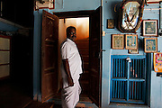 K.M Ramanathan, a local Chettiar who lives in his family mansion and works as Guest relations manager in the nearby Visalam hotel in Kanadukathan. Numbering more than 25,000, Chettinad's mansions were built by a Hindu caste of Chettiars called the Nagarathars. They were bankers and merchants who made their fortunes outside India in Burma, Malaysia, Vietnam and Singapore during the times of the British colonialism. With this new found fortunes they built mansions, exquisite palaces that rivaled those of even the Maharajah's using teak from Burma, marble form Italy, tiles from Japan and steel from England. But these glory days only lasted until after the WWII when the British left Burma and they were forced to leave return to India. Suddenly with no income their mansions began to decay and fall down or were pulled take and the pillars, windows, doors and antiques were sold. Some estimates say that around 20 per month are coming down. Hopefully, with the aid of preservation projects such as the Revive Chettinad Society, and the influx of tourism these mansions can be saved before they all fall down.