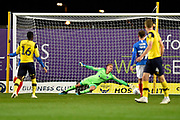 Alex Bass (35) of Portsmouth is beaten by a shot at goal by Matty Taylor (9) of Oxford United to give a 1-0 lead to the home team during the Leasing.com EFL Trophy match between Oxford United and Portsmouth at the Kassam Stadium, Oxford, England on 8 October 2019.