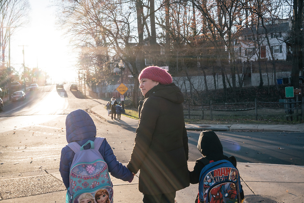 Eufronia Alba walks her daughter, Danna, 7, and son Nathan, 4, to the bus stop near her apartment in Arlington, Va. on Dec. 15, 2016. Alba and her husband, undocumented Bolivians, were in deportation proceedings but have requested cancellation of removal because Joshua, who is American-born, has cerebal palsy and depends on his parents for everything including bathing and feeding. CREDIT: Greg Kahn / GRAIN for the Wall Street Journal TRUMPLOOP
